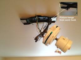 ceiling fan bracket. ceiling fan hooked to bracket
