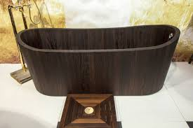 the dark color and elegant lines make this khis wooden bathtub a stunning addition for any