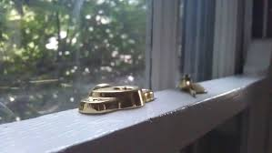 broken hardware on a double hung window
