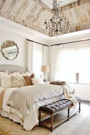 Chic Bedroom With Neutral Wall Color And Chandelier Over King Size Bed And  Using Wall Mounted