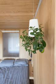 the bedrooms living lighting pop up all through the hall to the left displays a dangling version the minimalist function in an or else white area bedroom living lighting pop