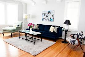 modern vintage charm mid sized eclectic enclosed living room idea in los angeles with white walls dark blue blue dark trendy living room