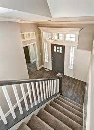 White Door Black Trim Entryway With Gray Stair Rail And White Balusters Gray Door And