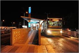 Image result for images of persons waiting for bus at bus stand at night
