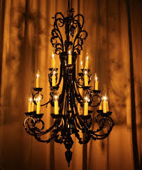 iron 3 level chandelier with amber wash
