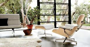 eames classic lounge ottoman in walnut and black vicenza leather