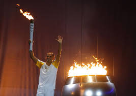 flame lighting olympics. watch: brazilian marathon hero de lima lights the olympic cauldron flame lighting olympics