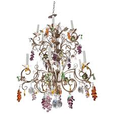 delightful louis xv style twelve light iron chandelier with colored fruit chandelier colored crystals