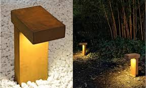 above the rusty outdoor path light is made of cor ten cast steel and is extremely weather proof the light is provided by a low voltage fluorescent ballast