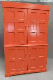 This piece has two large cupboard doors to top, which open up to reveal  fitted internal shelves; ...