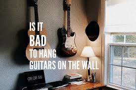 is it bad to hang guitars on the wall