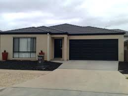 black garage door probably wver you put there is going to look normal once its white