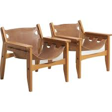pair of kilin armchairs in leather by sergio rodrigues for oca furniture 1970s