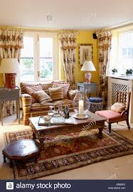 Striped Living Room Curtains Brown Striped Sofa And Floral Curtains In Yellow Living Room With