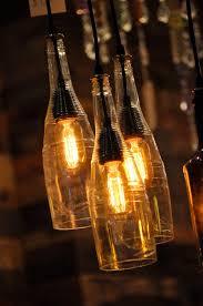 wine bottle lighting. recycled wine bottle hanging lamp with edison lightbulb industrial lighting chandelier 19900 via etsy