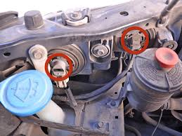1998 2002 honda accord headlights replacement 1998 1999 2000 image 1 2 detach the head light connectors by pushing on the lever on