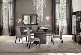 simple elegant contemporary dining room centerpiece with black bowl fruit stand and sophisticated chandelier 16