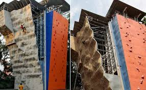 people trying the artificial wall climbing that is one of the adventure sports in pune on artificial rock climbing wall in pune with 8 adventure sports in pune its vicinity