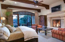 Luxury Master Bedroom With Stone Fireplace Wood Beam Ceilings And Outdoor  Balcony
