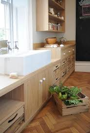 kitchen with trough sink and two faucets