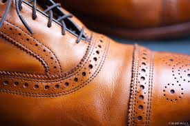 gentle creasing from a full grain leather shoe