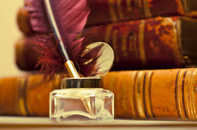 old books and quill