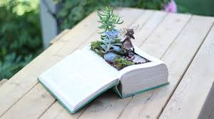 lovely vintage book fairy garden is such a unique idea