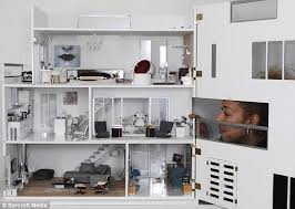 modern dolls house furniture. elaine peers through the front of her modern dolls house which opens to reveal all furniture