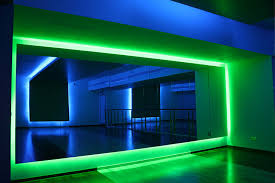 green led fixture architectural lighting design with large mirror and laminate flooring in white themed room