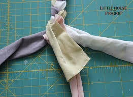 add a new strip of fabric by overlapping the last two inches and securing it as