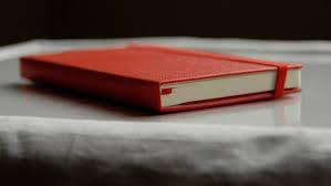 Resultado de imagen de escribir moleskine roja