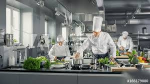 Restaurant kitchen Small Famous Chef Works In Big Restaurant Kitchen With His Help Kitchen Is Full Of Food Vegetables And Boiling Dishes Culinary Depot Famous Chef Works In Big Restaurant Kitchen With His Help Kitchen
