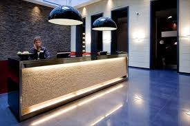 grey and white motive combine reception desk ideas with twin blue pendant lamps on blue glossy floor in white wall ceiling color on mesmerizing decoration