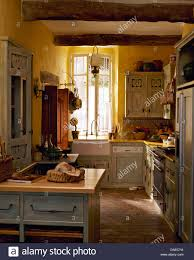 Terracotta Floor Kitchen Pale Gray Cupboards In Yellow French Country Kitchen With