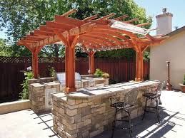 Exterior:Favorable Small Wooden Pergola Roof Over Outdoor Stone Kitchen  Counter Plus Iron Backrest Stools