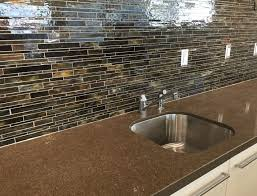 this close up shows the beauty of serenade glass mosaic tiles used for the backsplash in