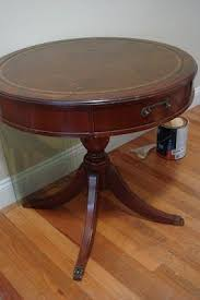 Antique leather top hard wood drop leaf coffee table. I Have This Table And Have To Re Do It It S The Exact Same Shape With A Few Different Details Made By Duncan Phyfe Parlor Table Salvaged Furniture Drum Table