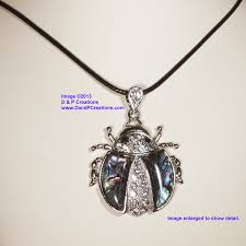 lady bug abablone shell pendant with black cord