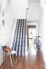a striped runner in shades of gray is a great addition to white surroundings