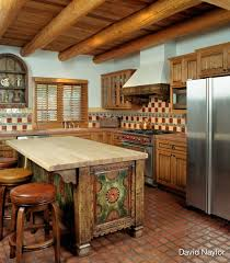 *In this kitchen, the island's design was inspired by an old New Mexican  trunk