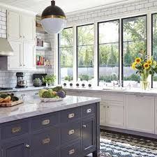 BECKI OWENS- blue and white kitchen with open shelving, steel ...