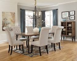 the tripton dining set bines the modern look of natural light tone on upholstered chairs with a tubular metal legged rustic wooden table