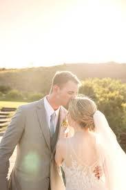 wedding dress outdoor florida sunset bride and groom portrait bride wearing plunging v neck fl lace