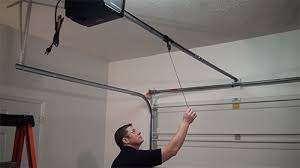 how to release the garage door opener in case of an emergency or power loss