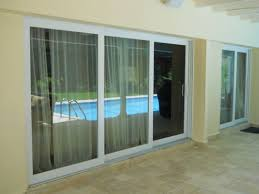 pgt series 770 o sliding glass door complete installation with stucco travertine marble repairs paint touch up done