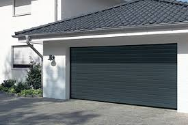 black small ribbed sectional garage door installed on a driveway