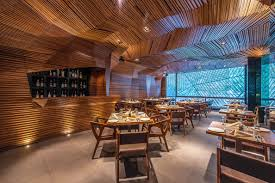 sanjay puri architects created the dizzying interior wood finish of the auriga restaurant in mumbai india with no but rather a pencil tied to a
