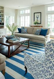 awesome coastal living room beige couch leaf pattern white and blue armchair dark blue cushions white
