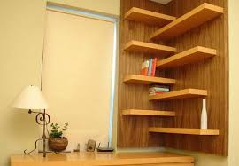 home shelves designs. small home office with wall shelves in the corner designs t