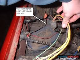 g alternator in w fireguy s harness need some help ford the alternator harness so can get rid of all the wires on the plug on this picture what does the little red wire do that goes to teh starter solenoid